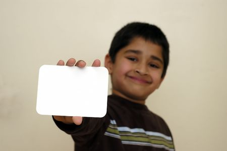 A handsome kid holding a sign ready to put your text Stock Photo - 822542