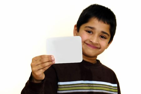 A handsome kid holding a sign ready to put your text photo