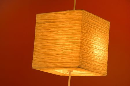 A Decorative light isolated on a red background photo