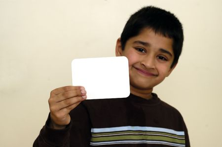 A handsome kid holding a sign ready to put your text Banco de Imagens