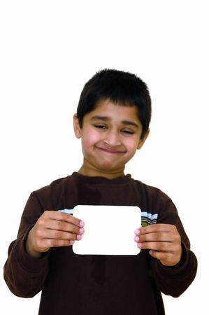 A handsome kid holding a sign ready to put your text Imagens