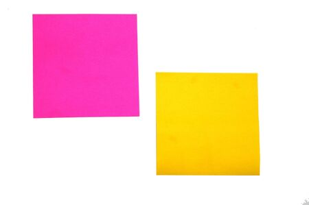Yellow and Pink stickies  isolated on a white back ground photo