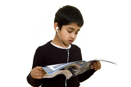 concurrent: A kid listening to music and reading conceot of multi tasking