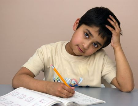 disinterest: A kindergarten kid not interested in doing his homework