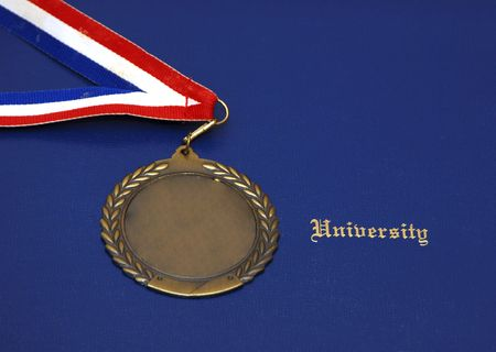 A Certificate and a gold medal on a blue pad - concept of graduation 版權商用圖片