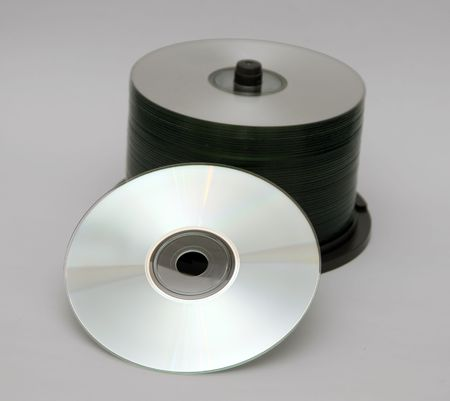 A rack of Compact disks isolated on white background photo