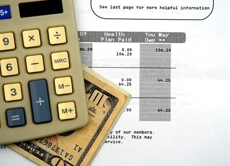 hmo: Calculator medical statement and dollor bills - Concept of rising healthcare
