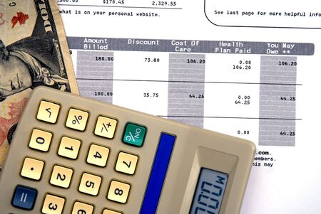 Calculator medical statement and dollor bills - Concept of rising healthcare