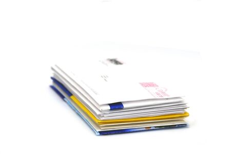 Pile of business letters isolated on white background