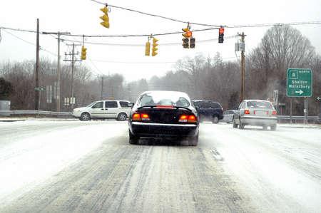 Card driving through a terrible blizzard
