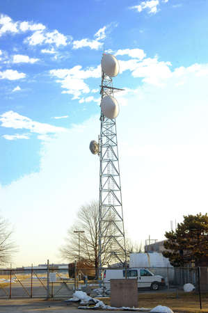 Communication tower on a bright sunny day Stock Photo