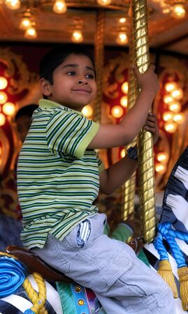 An handsome indian kid having fun at a local carnival Imagens - 958411