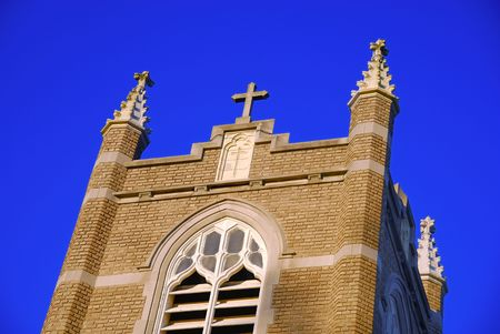 workship: Frontal view of the church against a blue sky