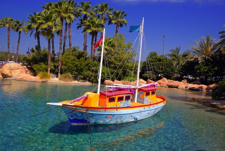 A beautiful boat on a tropical island Stock Photo