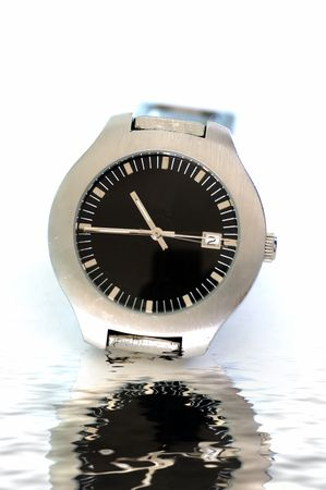 A male wrist watch isolated against a white background