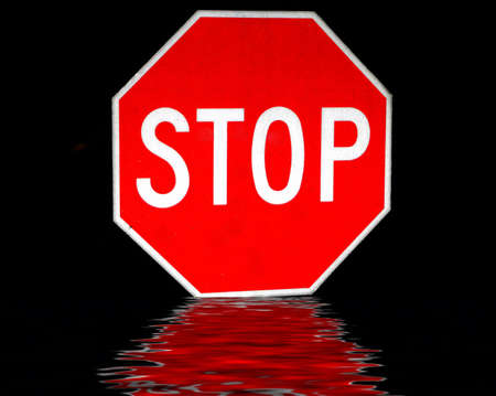 stop sign isolated on black background with reflection photo