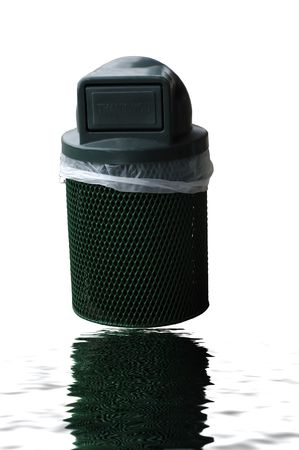 A Green Trash can on the side of a pavement Stock Photo - 1186793