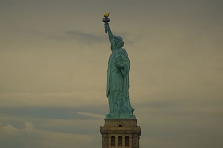 Statue of liberty on a cloudy overcast day photo