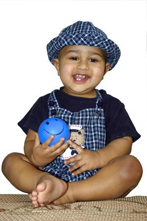 A stylish bald Indian kid happy with a smiley face Zdjęcie Seryjne