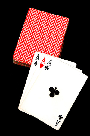 Three aces laid pn a deck of cards