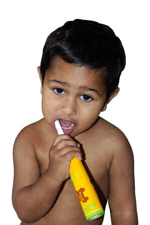 An young toddler learning to brush his teeth Stock Photo - 2373298