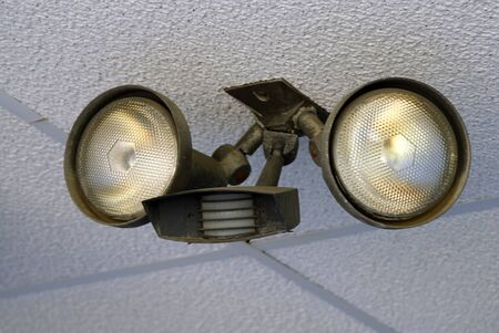 Motion sensor light mounted on a building wall photo