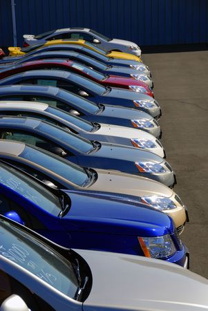 A row of new cars parked at a car dealer shop Stock Photo - 1888800