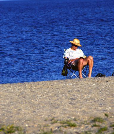 Man enjoying the summer sun at a local beach Stock Photo - 2028599