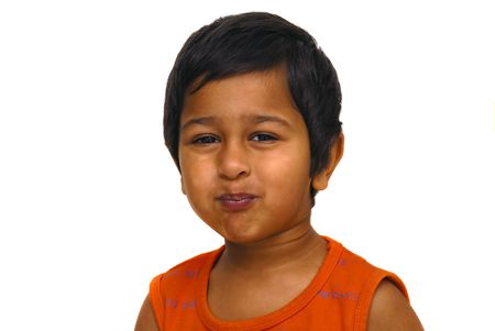 unruly: An handsome indian kid playing pranky face Stock Photo