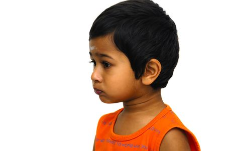 perverse: An handsome indian kid playing pranky face Stock Photo