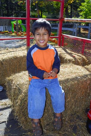hayride: An handsome indian kid having fun with hay ride