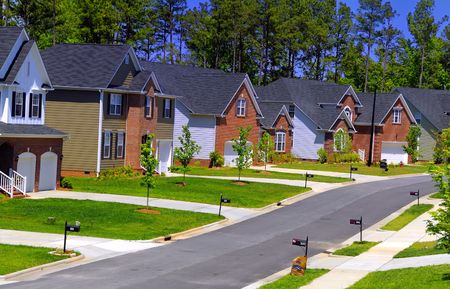 A set of newly built colonial houses in a subdivision