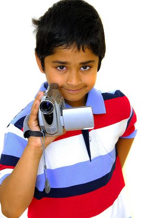 An handsome Indian kid holding a video camera