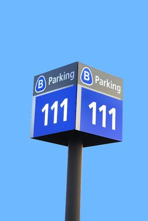 signboard: A parking sign board isolated against a clear blue sky Stock Photo