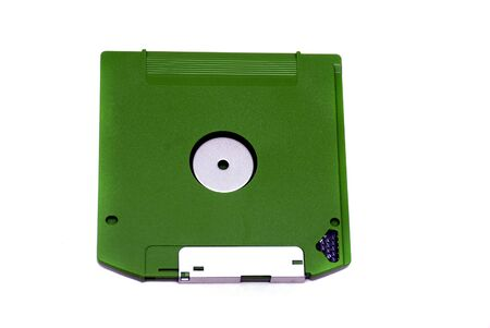 Green floppy disc isolated on a white back ground