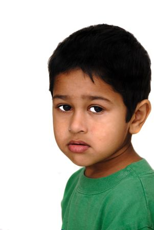Young Asian Indian kid looking very sad photo
