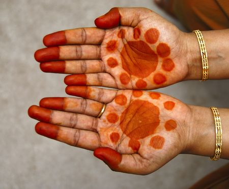 a design on hands against a natural back ground photo