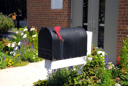 An old mail box in front of a brick building Stock Photo - 2346658