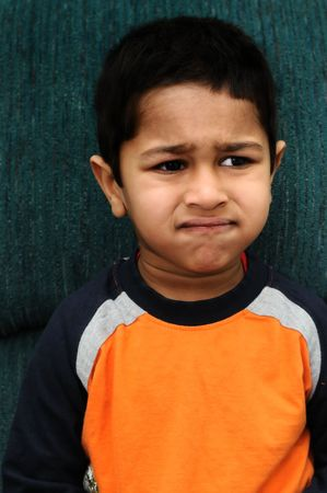 An handsome Indian kid looking very disappointed photo