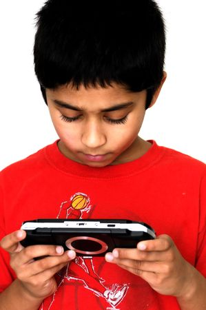 xbox: An handsome Indian kid getting addicted to video games Stock Photo