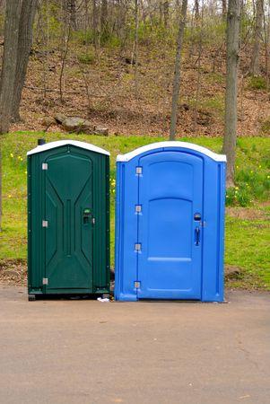 lav: Two colorful public toilets on a bright spring day Stock Photo