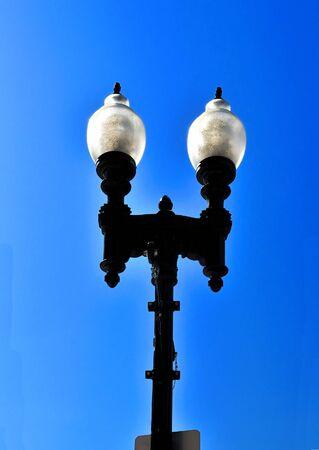 A streetlight isolated against a bright blue sky