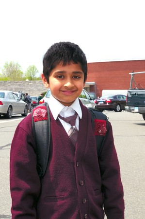 An handsome Indian kid ready to go to school photo
