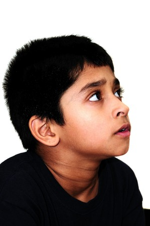 An handsome Indian kid awestruck watching television Imagens