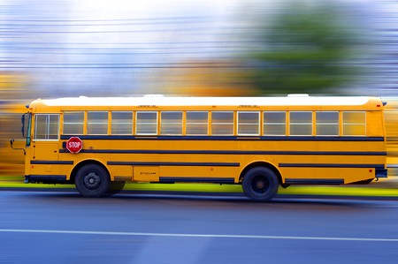 A school bus speeding on a local rad