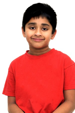 An handsome Indian kid posing for a portrait Фото со стока