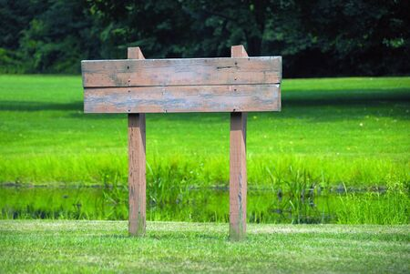 yard sale: A blank wooden sign ready for your text Stock Photo