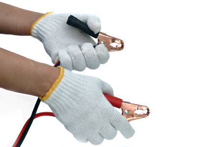 uto: Hands and gloves with car jump start cables Stock Photo