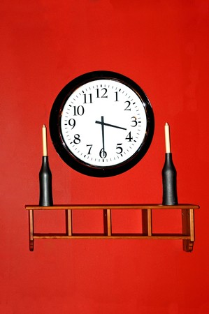 A beautiful walkl clock hanging against a red wall Stock Photo - 4190508