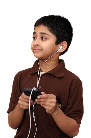 An handsome Indian kid hearing music with headphones photo